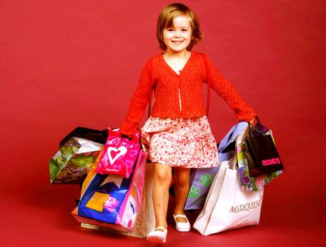 Toddler with shopping bags.